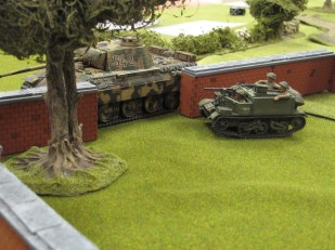 A Panther trying to block a Universal Carrier's way...the carrier reacted by driving right up under the Panther's gun!