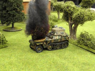 A German recce halftrack paying the price for being a bit too bold.