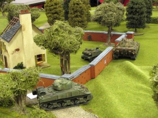 A Sherman tries to help the boys in the carrier out.