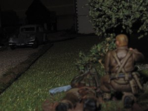 In the dark, the sniper pegs the German officer as he speeds down the road.