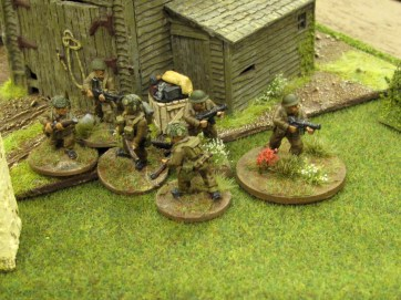 The platoon sergeant leads the remains of a section onto a German JOP