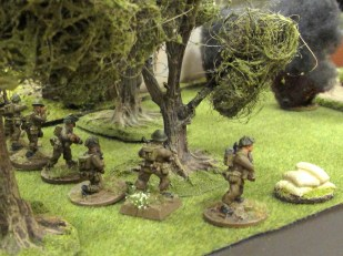 Behind a rolling barrage, the Brits move up and take a German JOP