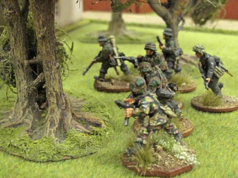 German troops probe through the woods
