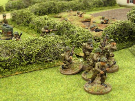 With fire going into the German position, a section moves up to root them out