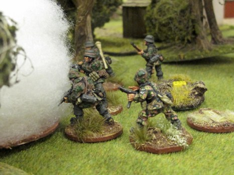 "Smoke from 2"" mortar and small arms fire plaster the Germans. Note the six pips on the shock dice."
