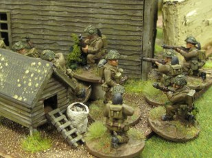 British troops infiltrate the farm through the breach in the wall...