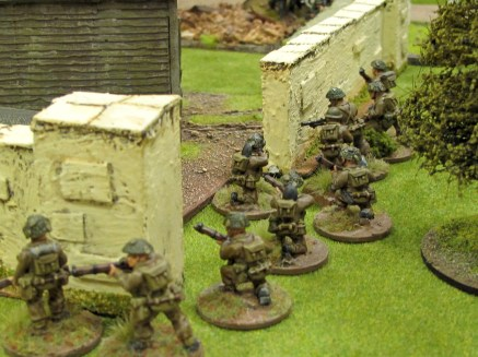 British infantry move up to the breach left in the farm wall by the engineers