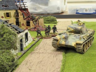 German infantry accompany the Panther as it advances on the British position