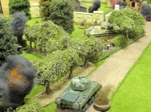 Two Shermans down, and the lone survivor moves in to get a flank shot on the Panther...