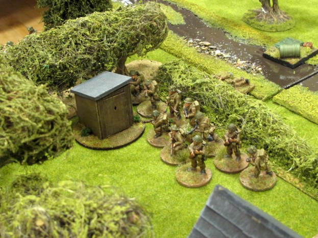 A second British section deploys near the orchard...