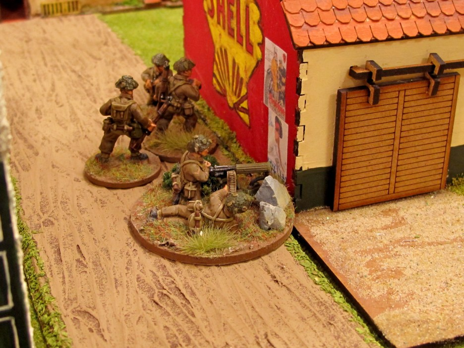 A British Vickers tries to silence the AT gun and own the road