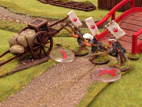 ...and hit two of the three rebel soldiers. One is badly wounded.