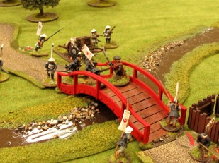 The spearmen fall back and Han charges over the bridge into danger...