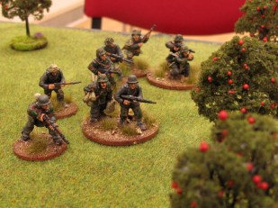 The German reserves reorganise in the orchard