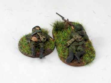 A casualty from the 1st Guard Lilliputian Division. Honestly the size difference doesn't bother me, as the casualty markers will mostly sit next to things that aren't miniatures, such as bunkers