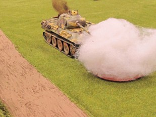 Shrugging off 75mm hits and blinding smoke the Panther soldiers on