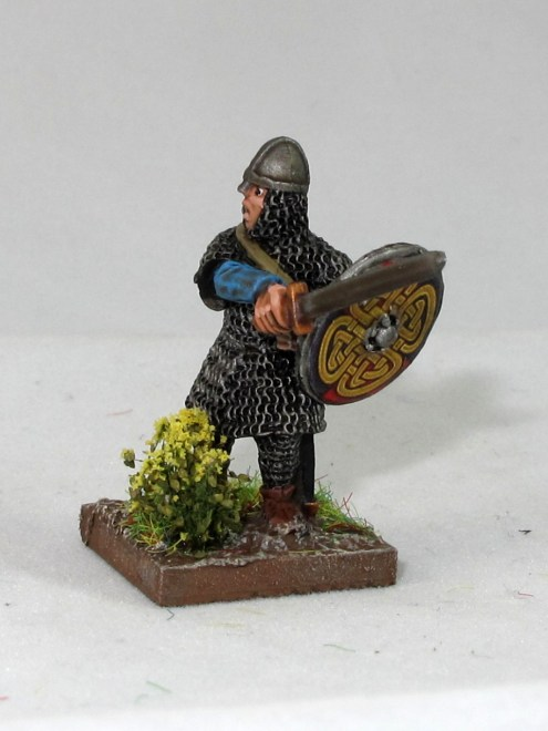 A couple of the more interestingly posed miniatures. The flowers mark this guy as a the leader, a Breton Machtiern leading his sworn men.