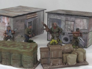 A couple of test shacks for a papercraft shanty town I'll do soonish