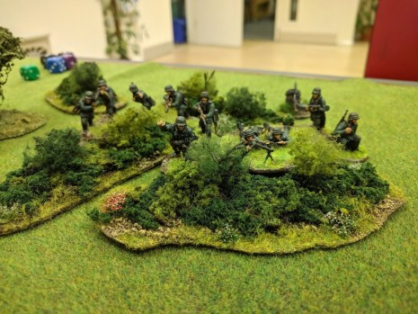 The first Germans take up position in a patch of scrub