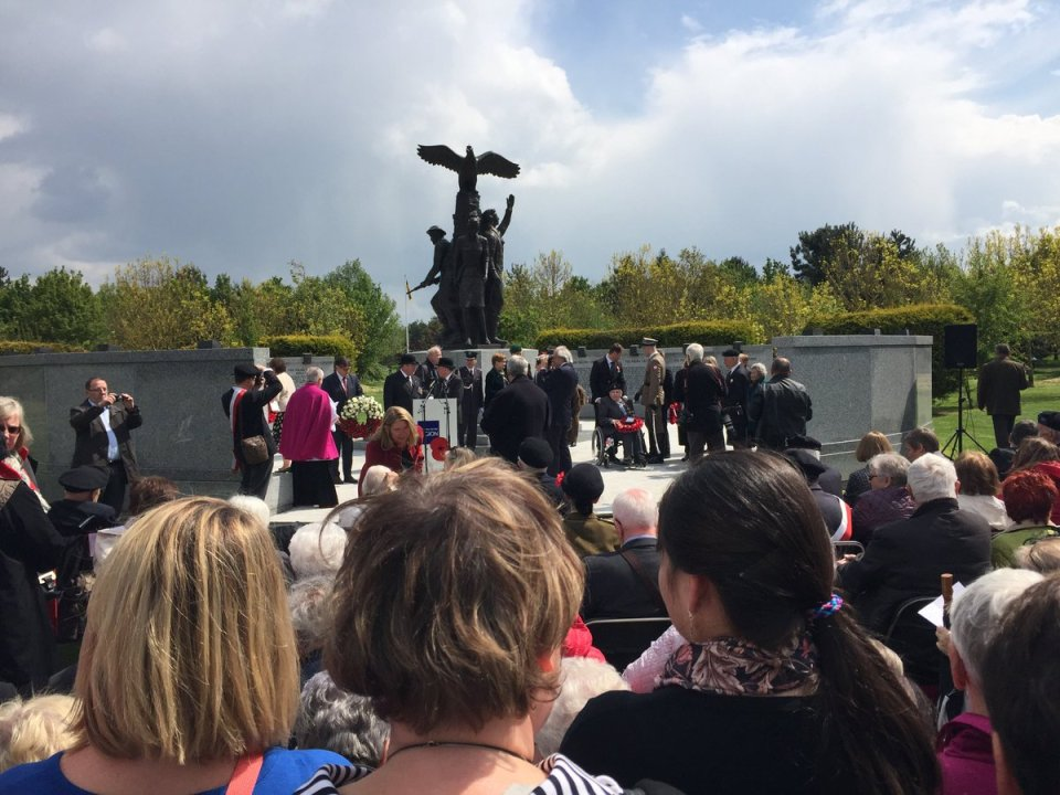 Crowds gather at a remembrance ceremony