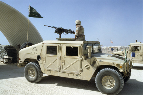A Humvee with a heavy machine gun and flying a Saudi flag