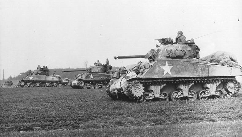 Sherman tanks advance near Arracourt, Sept 1944