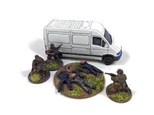 The militia prepare to bundle their hostages into the van