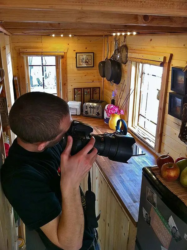 Christopher photographing house