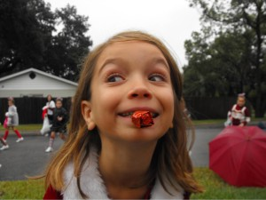 With her favorite candy in her mouth, she celebrates parade day in 2009.