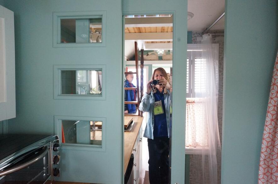 Sliding bathroom door in tiny house.