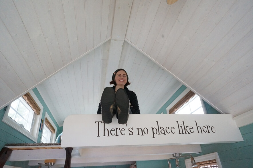 Amy Henion in the Periwinkle tiny house loft.