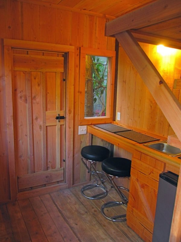6x10-treehouse-inspired-tiny-house-built-with-scraps-by-molecule-tiny-homes-006