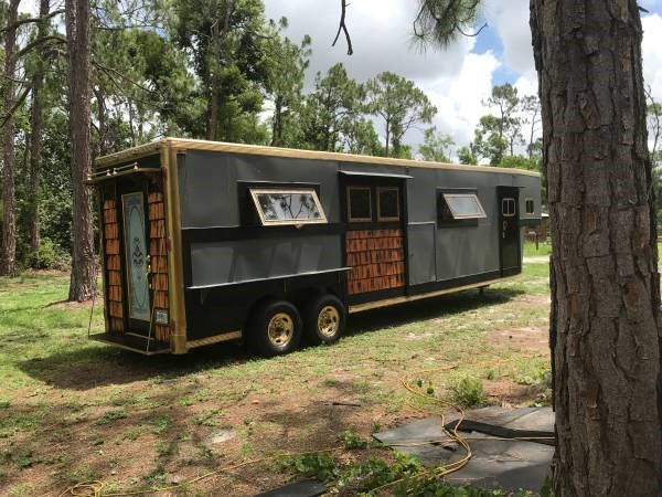kitchen cart with wheels refacing horse trailer converted into a tiny home
