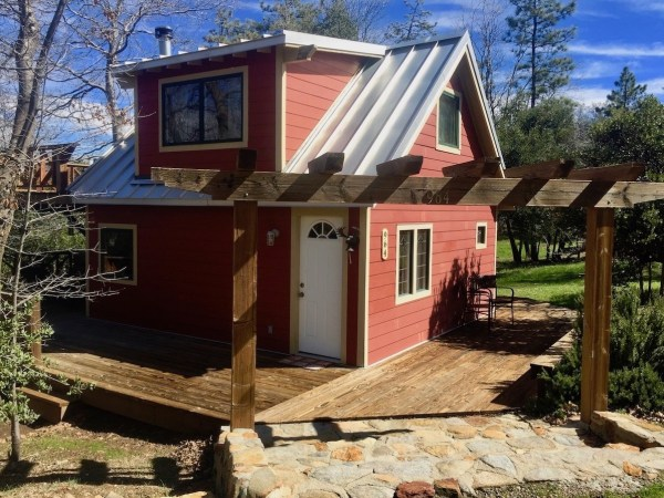Little Red Cabin With A Metal Roof In Julian California