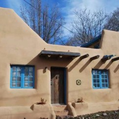 House Of Turquoise Living Room Floating Shelf On Wall 510 Sq. Ft. Small, Pueblo-style Solar Home For Sale In ...