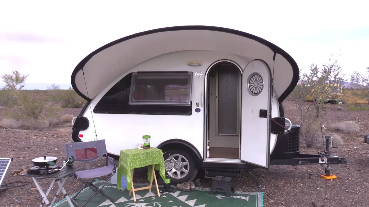 retired nomad woman living in her teardrop trailer w jeep. Black Bedroom Furniture Sets. Home Design Ideas
