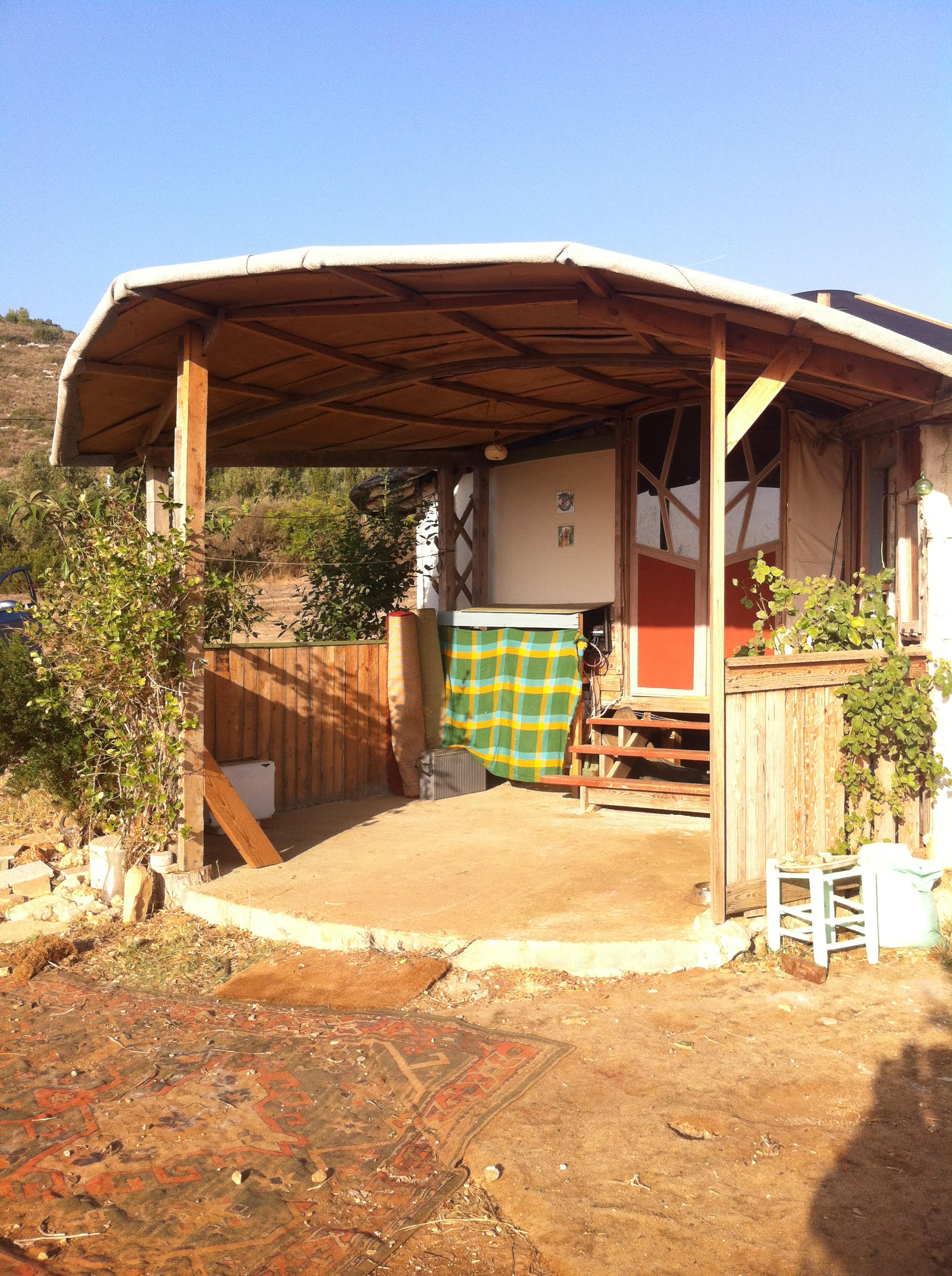 Man and Son Living in Renovated Yurt