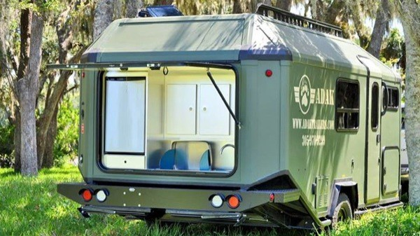 man designs  builds and produces off grid micro cabin trailer