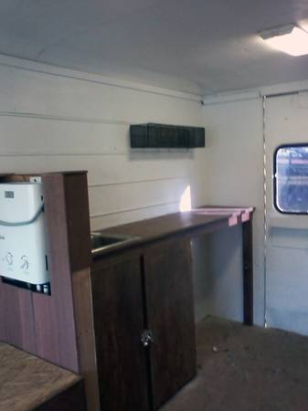 Man Converts Work Van into Stealth Van Dweller For Sale