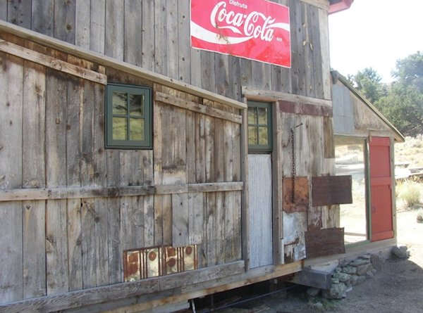 Reclaimed wall from a chicken coop used in this small rustic cabin