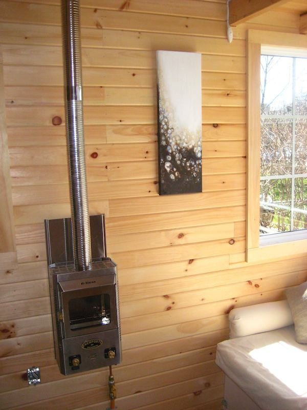 Dickenson Fireplace inside Lush Tiny House
