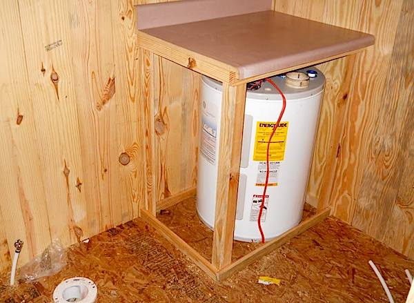 Left Over Countertops Used for Water Heater Enclosure in Bathroom