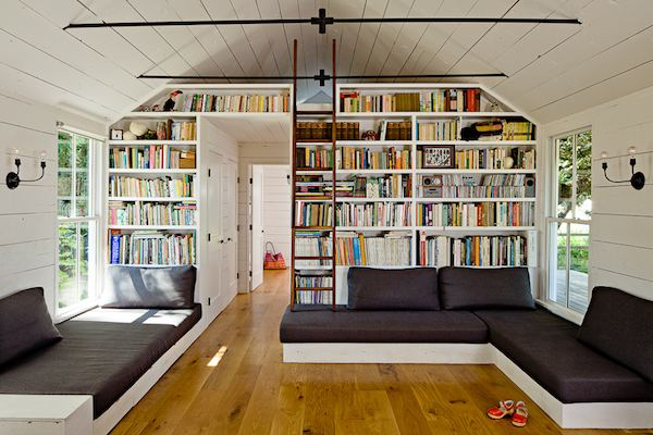 Living Room with tons of Book Shelves inside Tiny House