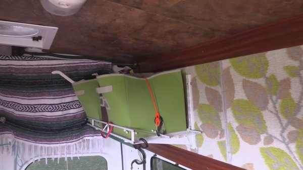 man-living-off-grid-in-nissannv-2500-van-006