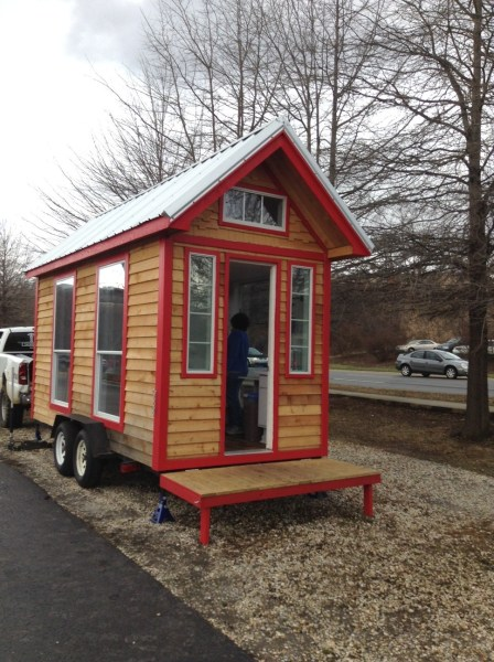 Visiting TIny Home parked on a busy Asheville street. Photo by Laura M. LaVoie