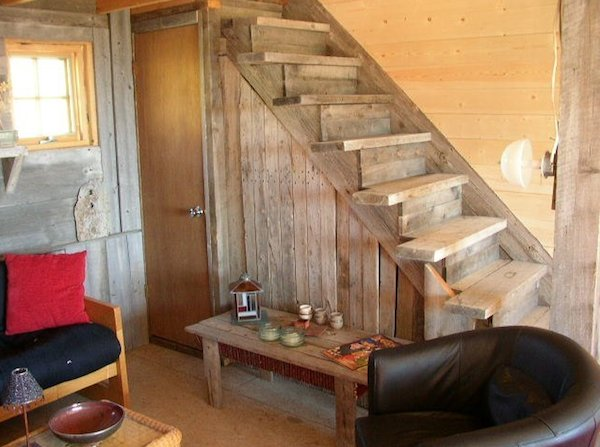 Storage in living area of small rustic cabin