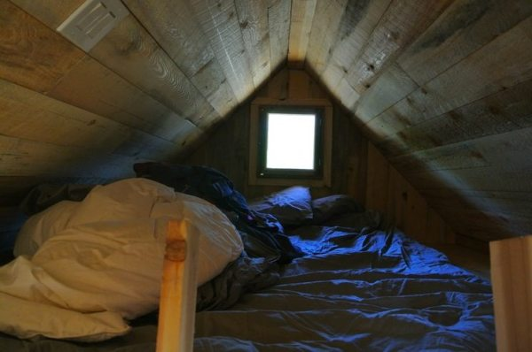 stanley-rocky-mountain-tiny-houses-log-cabin-on-wheels-flipping-overhangs-greg-parham-00011