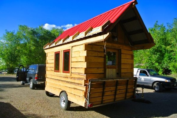 stanley-rocky-mountain-tiny-houses-log-cabin-on-wheels-flipping-overhangs-greg-parham-00015