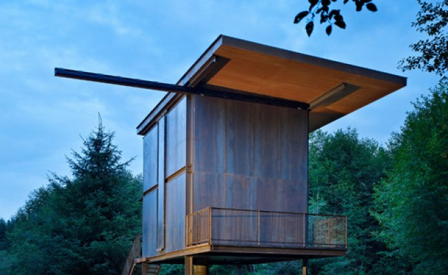 Steel Clad 350 Sq Ft Modern Cabin On Stilts With Shutters