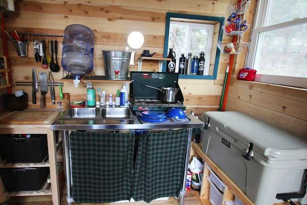 kitchen cabinet blueprints table decorations young couple build mortgage-free, off-grid micro cabin